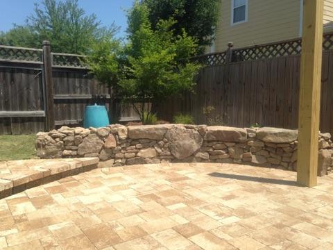 Backyard Patio with Fieldstone Wall
